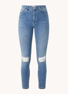 High waist skinny fit cropped jeans met stretch en ripped details