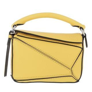 Crossbody bags - Nano Puzzle Bag Classic Calfskin in geel voor dames